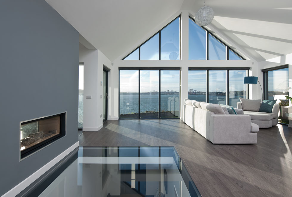 fixed glazing in the living room floods the space with natural light and makes the most of views