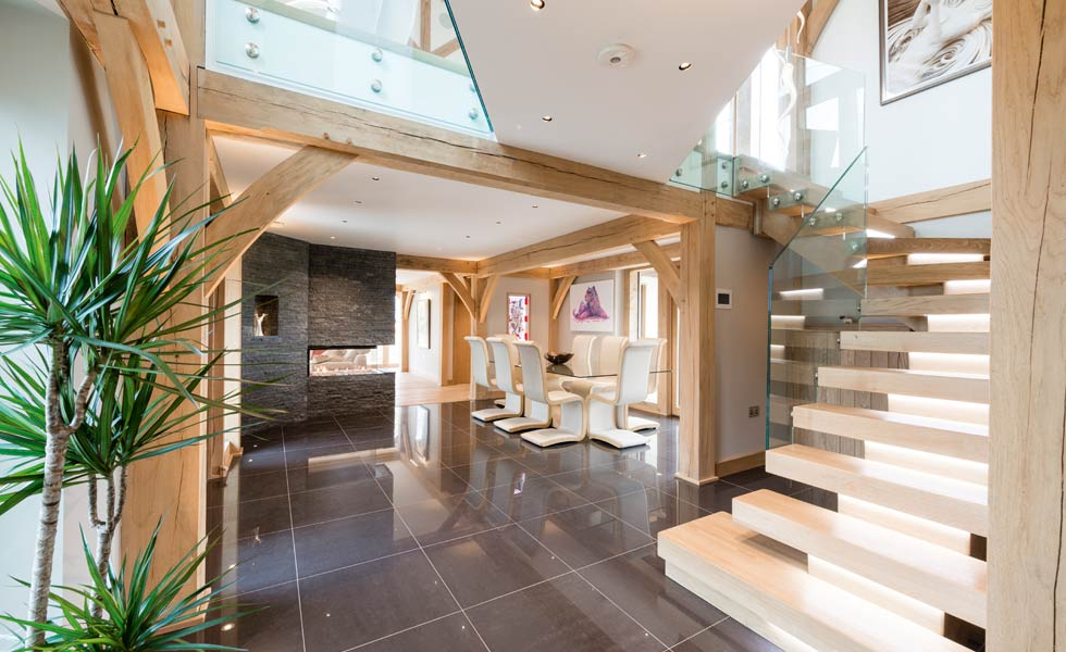 exposed oak beams and stylish contemporary staircase and dining area