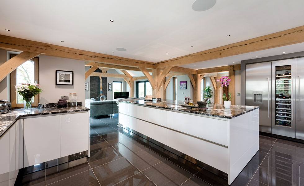 contemporary kitchen with exposed oak beams