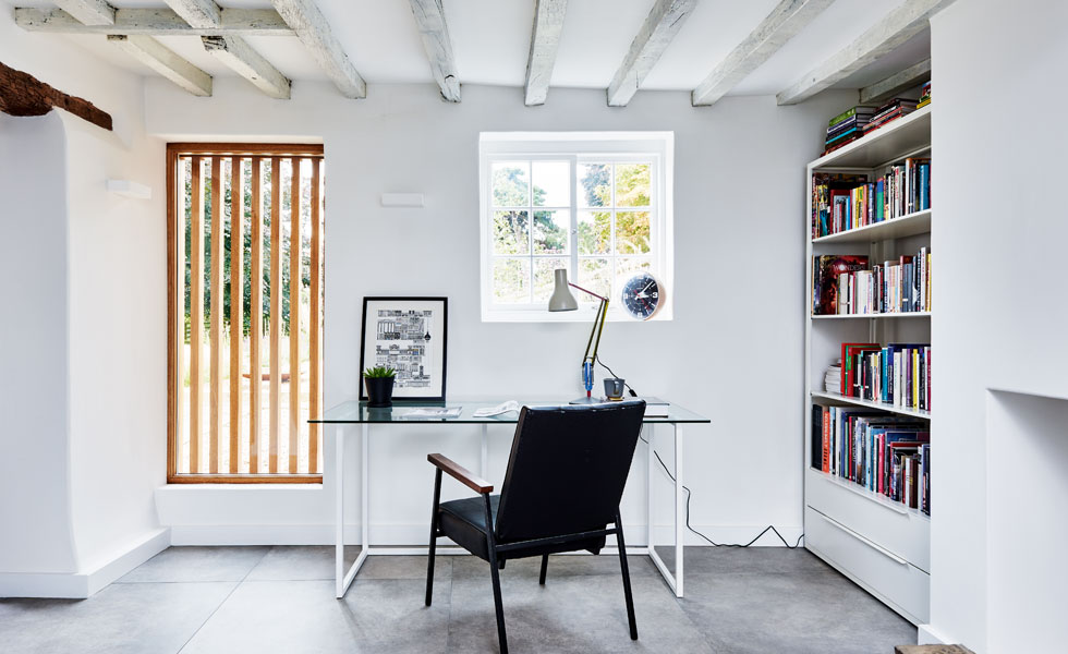 A former doorway has become a feature window thanks to the addition of some wooden shutters