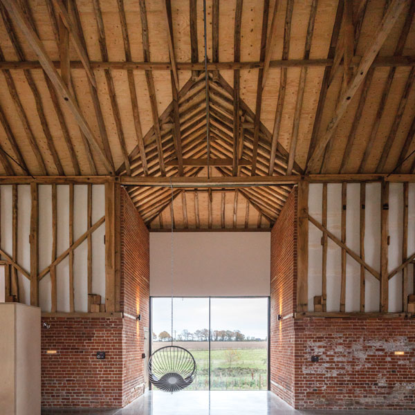 Bespoke glazing was chosen to make the most of the former entrance in this barn conversion