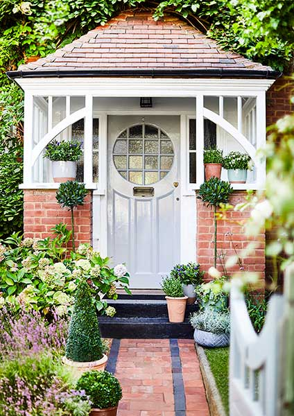 Porch with hanging basket and old door