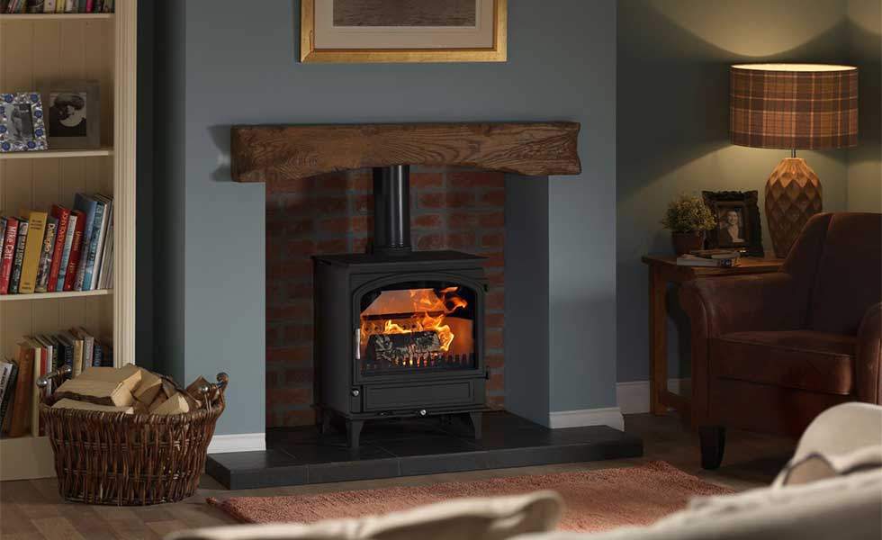 Woodburning stove in inglenook fireplace