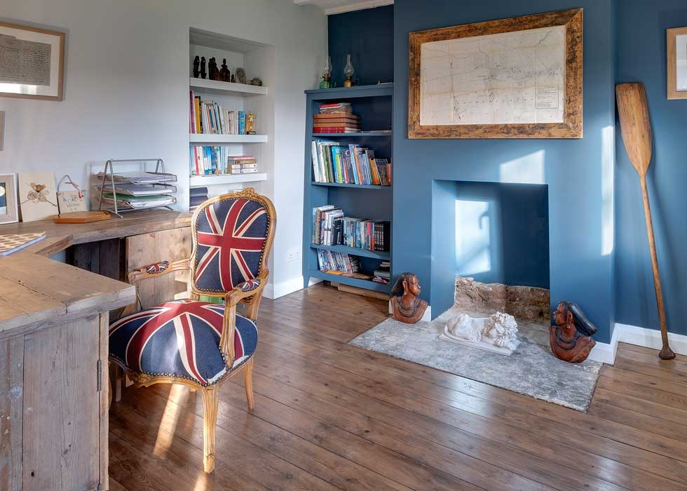 home office with blue walls and union jack chair