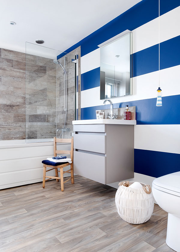 white bathroom with blue and white feature wall