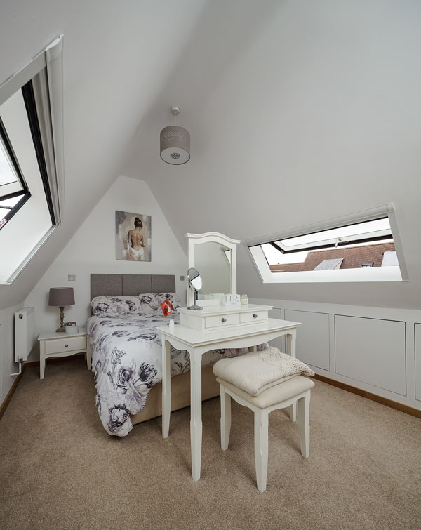 bedroom with vaulted ceiling and rooflights
