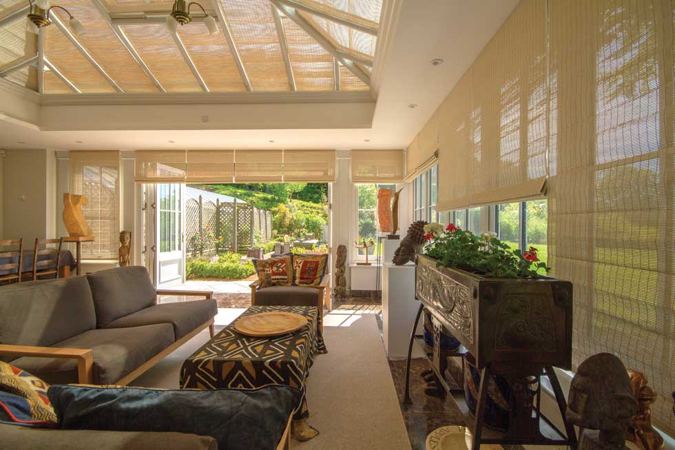 sunroom with blinds to create shade during the summer months