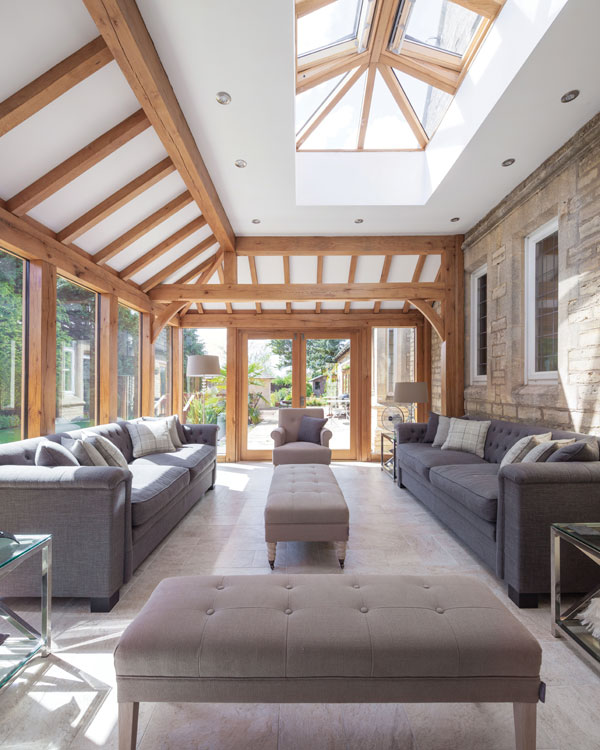 sunroom interior with grey sofas