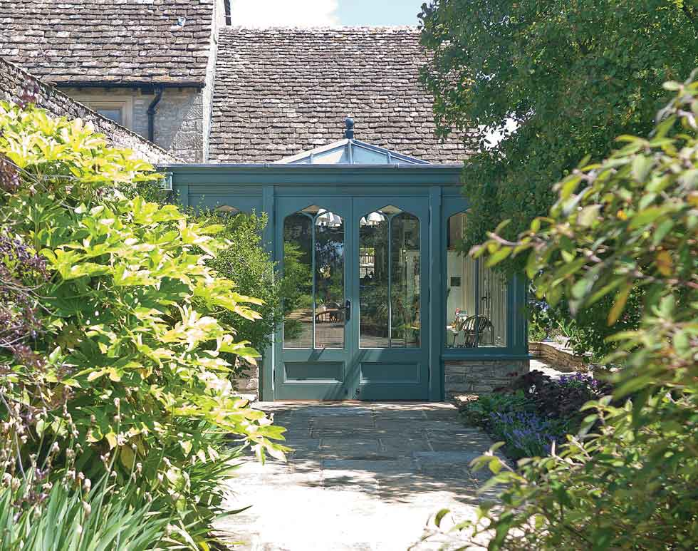 characterful patio doors from sunroom to garden