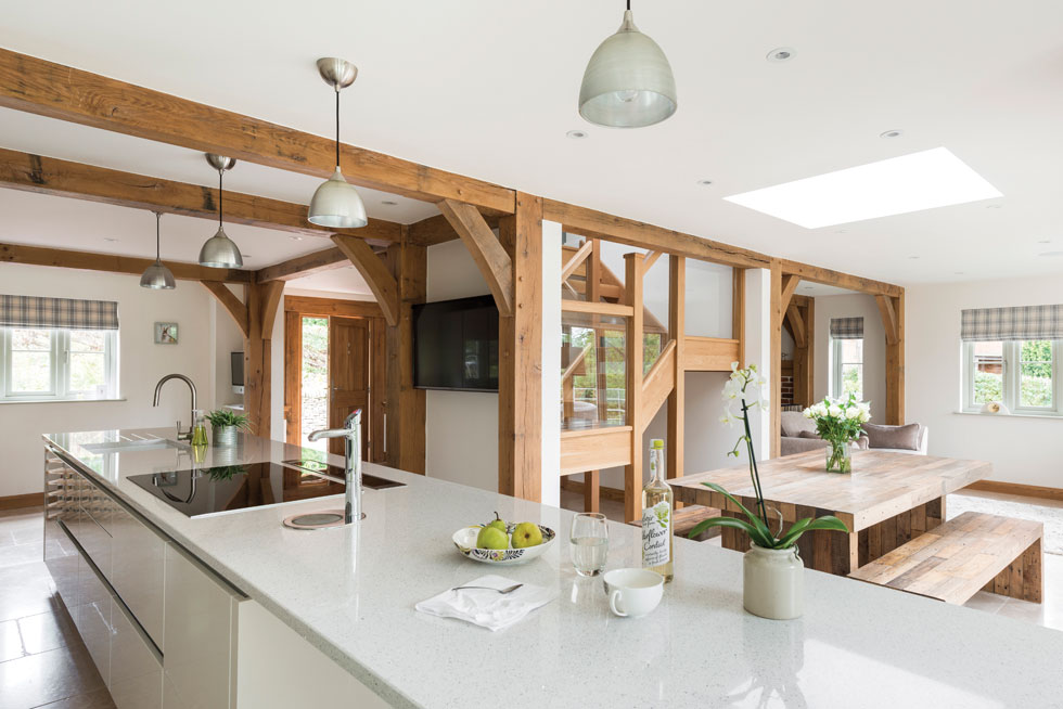 Contemporary kitchen with visible oak beams