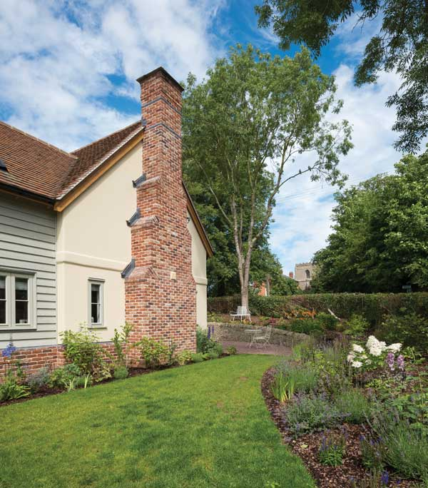 oak frame house with partial brick cladding