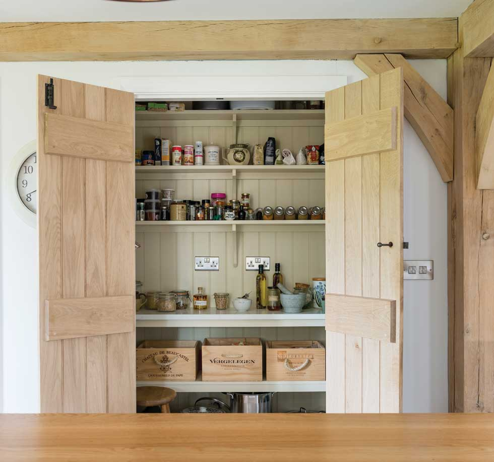 Incorporate a pantry to keep food and appliances hidden behind closed doors