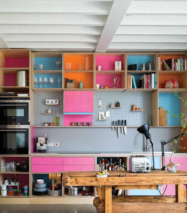 Open wall units and pegboards provide extra options for kitchen storage