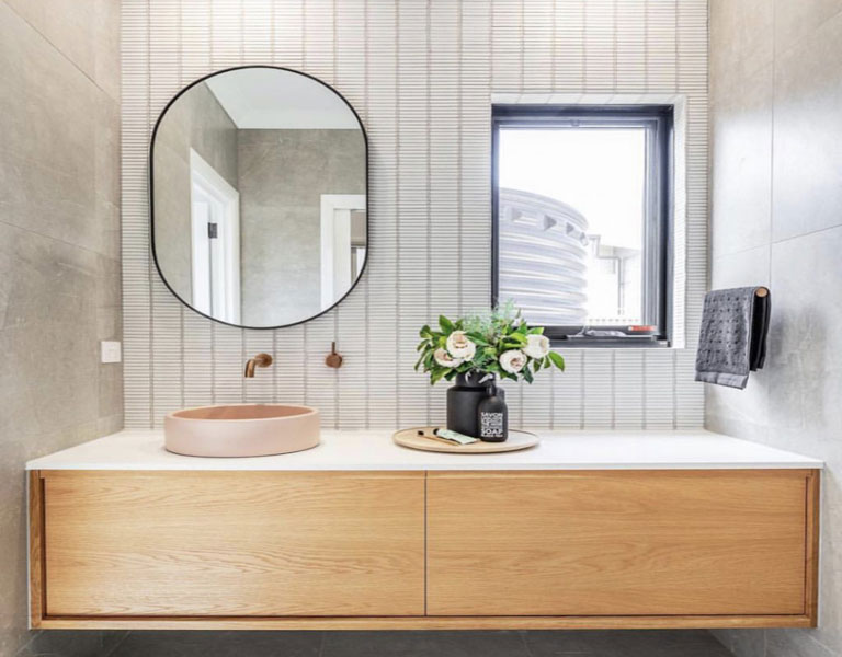 Wood panelling in bathroom with countertop basin
