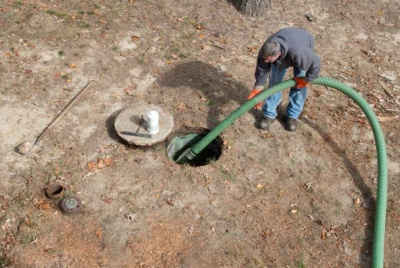 Man draining septic tank