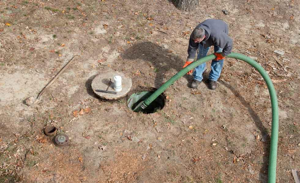 Man draining septic tank