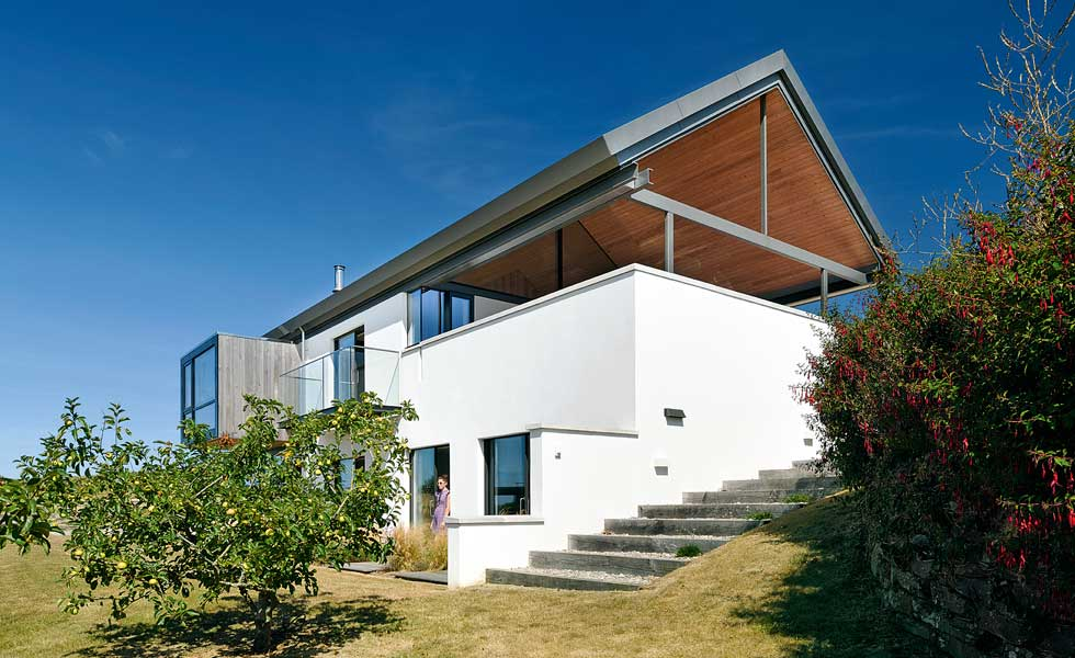 Render, timber cladding and fixed glazing comprise the property's exterior