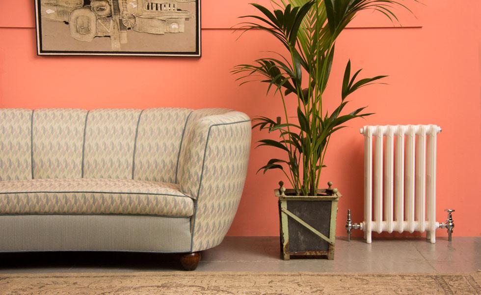 Column radiator in pink living room