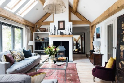 The fireplace and placement of the furniture help to zone the living room in this predominantly open plan ground floor layout