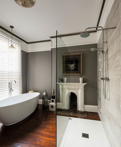 Contemporary bathroom with period fireplace