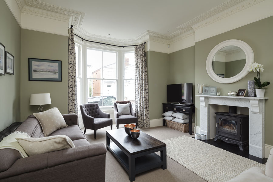 Living room with high ceilings and original features