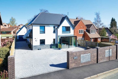 Glazing and open plan layouts combine to provide visibility over the front driveway