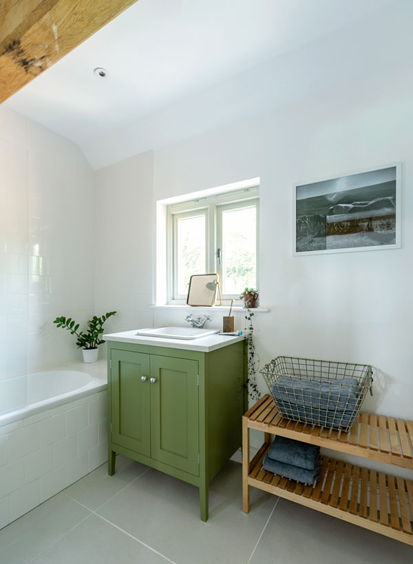 Bathroom with green vanity unit