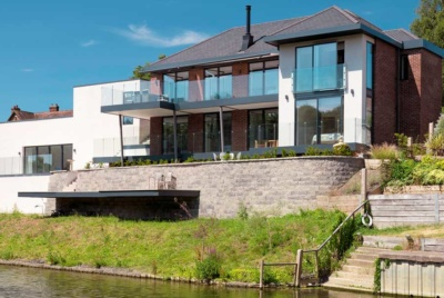 Contemporary self build on a riverside plot