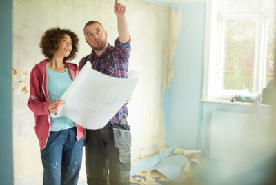 Couple looking at home improvement plans