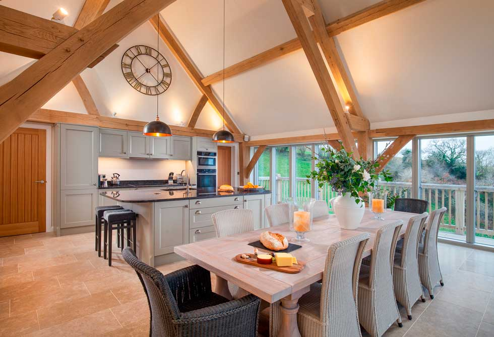 Open plan kitchen diner with exposed oak beams