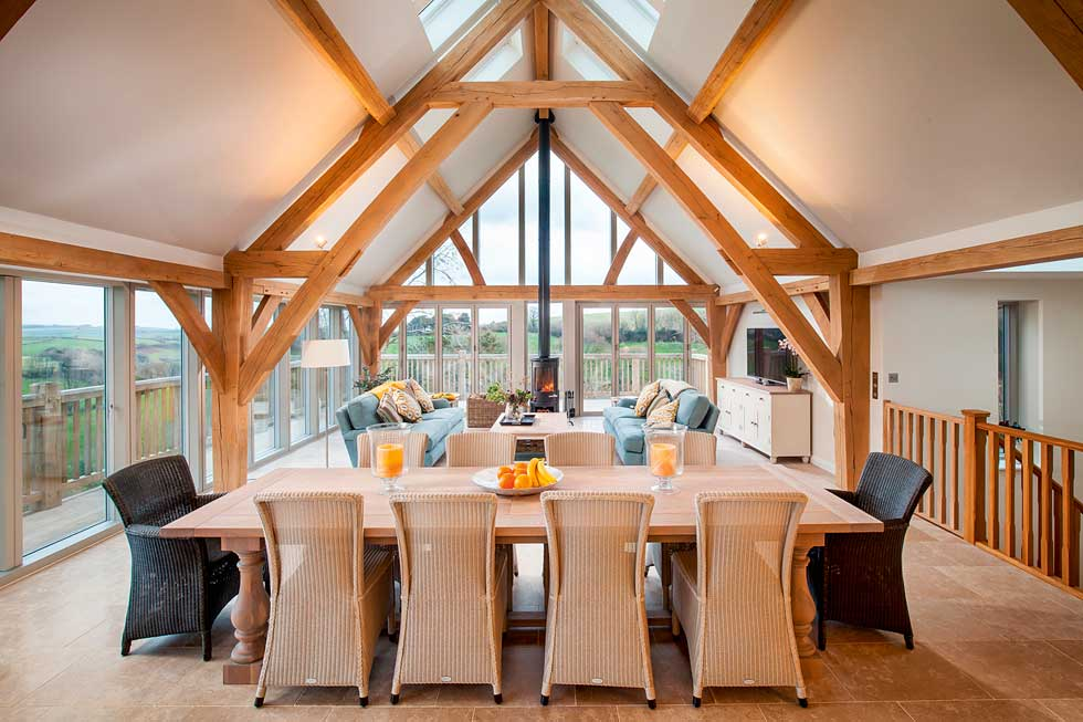 exposed oak beams in open plan kitchen-diner-living space