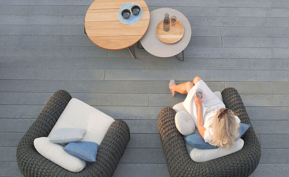 Outdoor seating area with wood-effect decking
