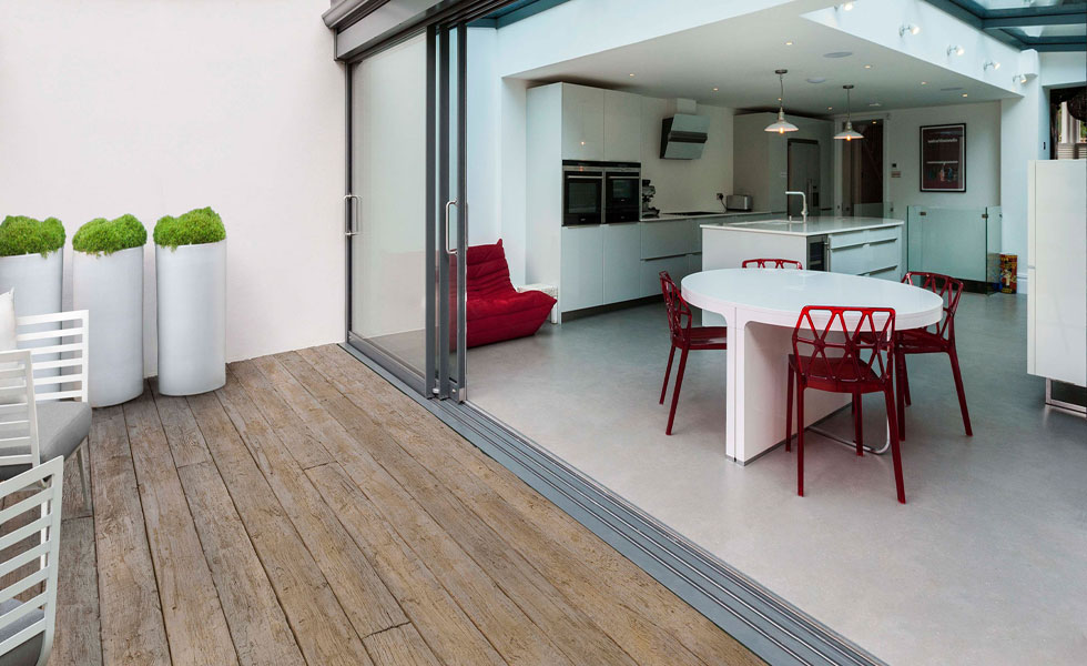 Sliding doors leading to wood effect decking on terrace