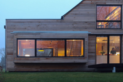 Contemporary house with untreated cedar cladding