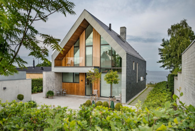 Contemporary house with slate, timber and render cladding