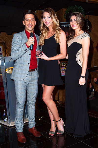 Luisa Zissman and Russell Kane present Lexi Lowe with the Paul Raymond 2014 Girl of the Year Award