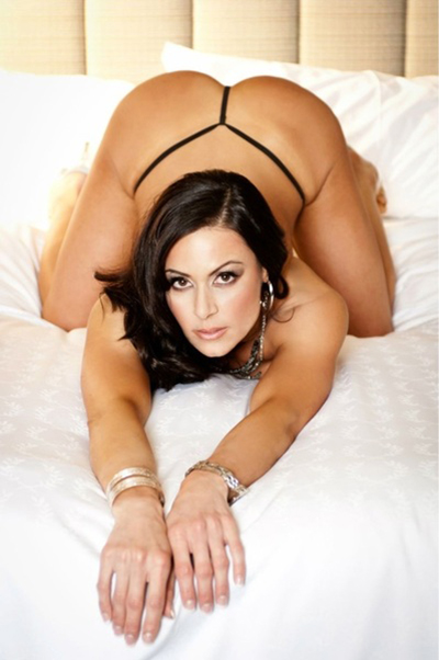 Kendra Lust naked on a bed