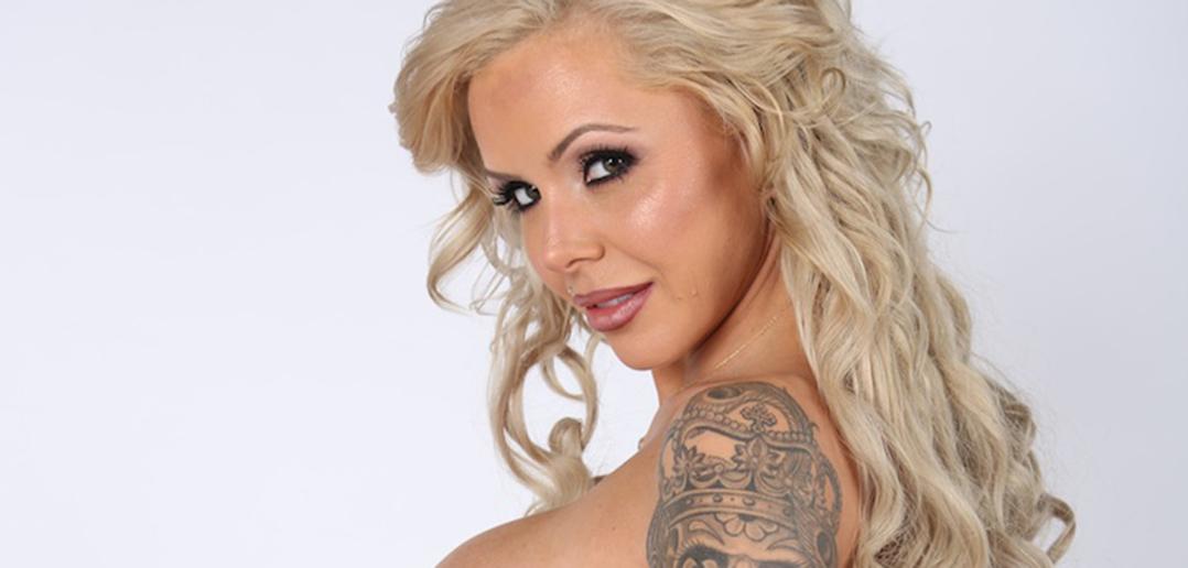 Nina Elle is arresting as a busty cop on patrol