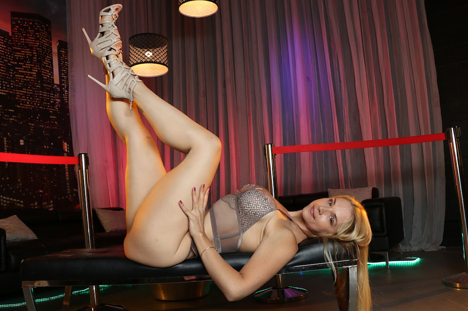 porn star Sarah Vandella lying on her back with long legs in the air