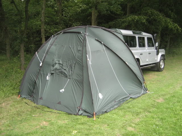 I like the tents that attach to the Defender so it can be utilised as a kind of big cupboard and you can take your light from it easily as well. & DEFENDER2.NET - View topic - Tent Recomendations?