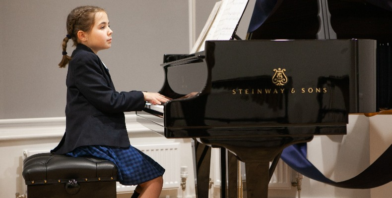 Year seven pupil Amelie playing one of the new pianos