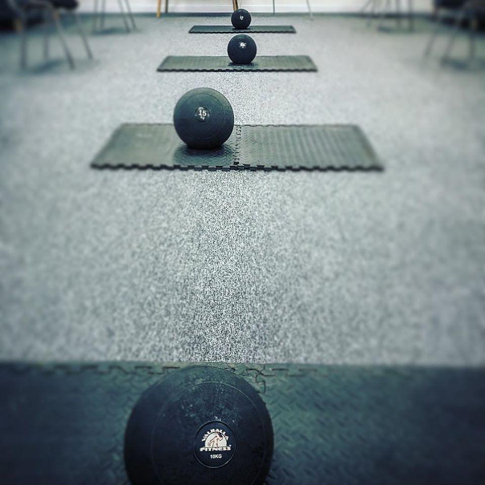 Medicine balls on fitness mats