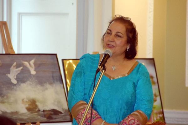 Jai welcoming as part of her hosting the poetry recital at the exhibition