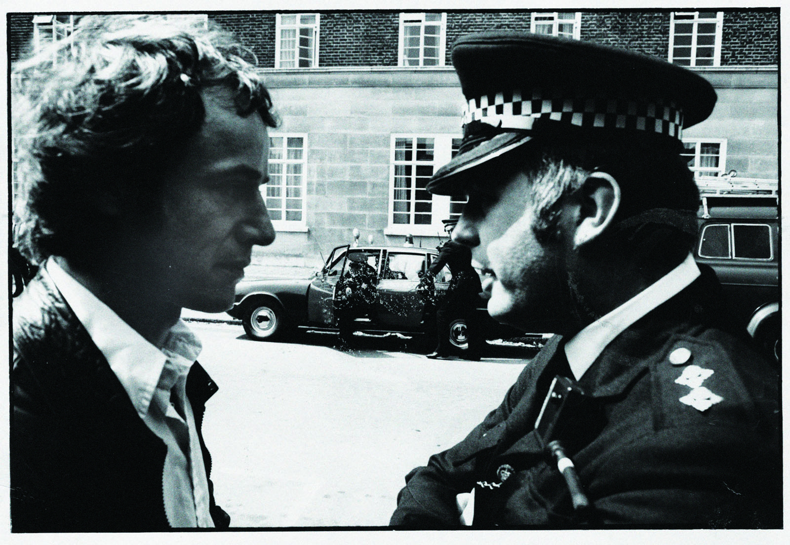 Duncan Campbell talking to a police officer at a demonstration in the 1980's.  Credit unknown.  Supplied by Duncan Campbell