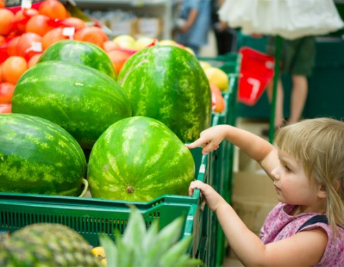 girl-water-melons-supermarket