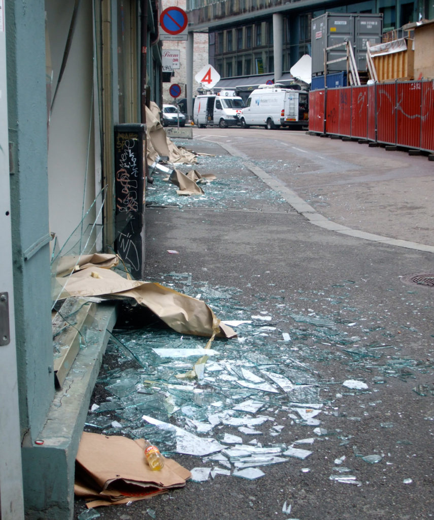 A shop window after the Oslo bomb