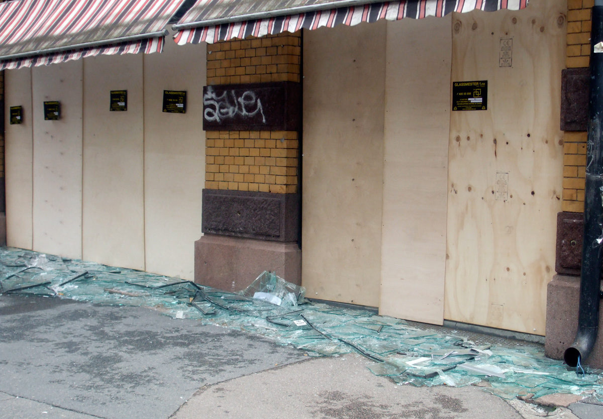 A shop with its glass windows blown out following the Oslo bombing