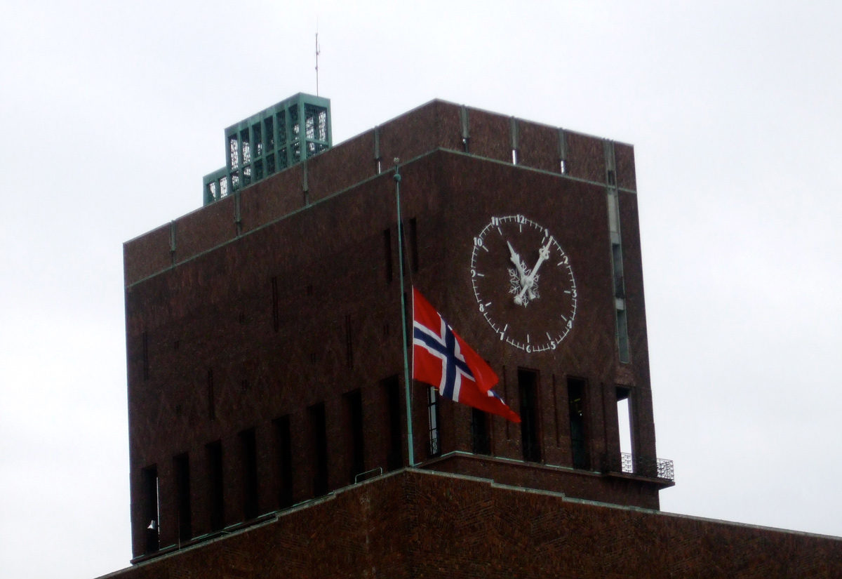Oslo City Hall flying the Norwegian flag at half-mast
