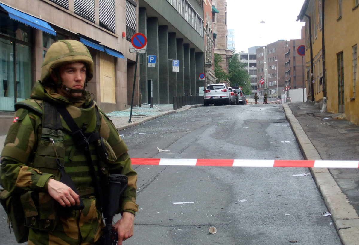 An armed soldier stands guard following the Oslo bomb