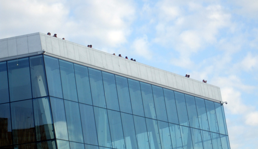 People on the roof of the Opera House, Oslo